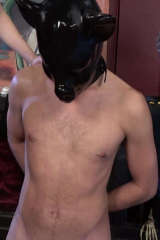 Nude slave in black rubber piggy mask