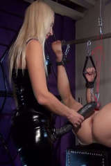 Lady Erica with big black strop on