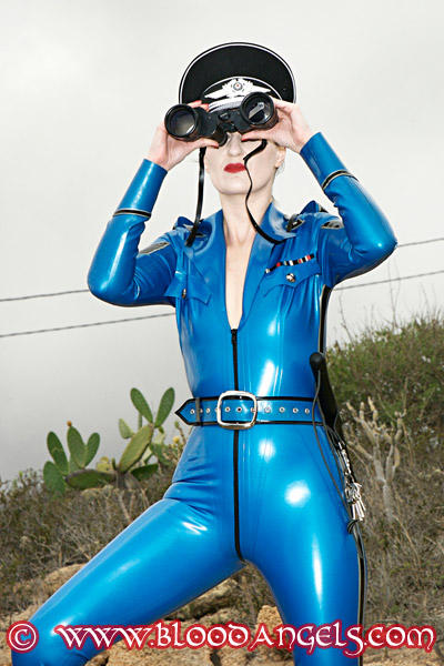 Lady Cora in blue Latex watching outdoors