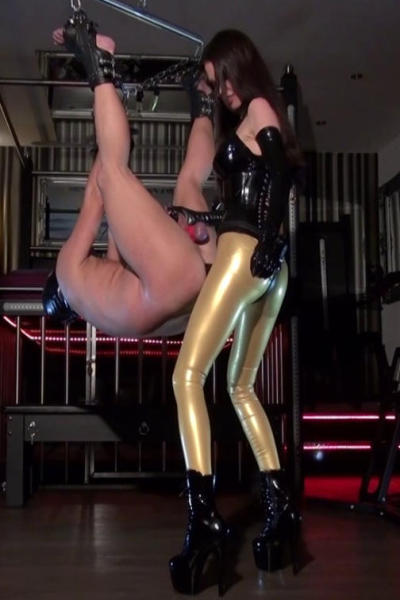 Lady Caprice in shiny latex dress and black plastic dildo