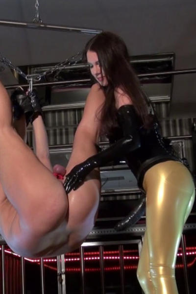Latex Lady Caprice and slave in the dungeon
