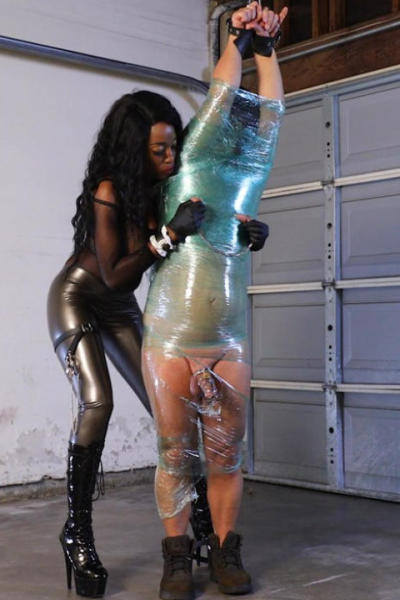 Lady MARTINA in latex dress in wrapping action
