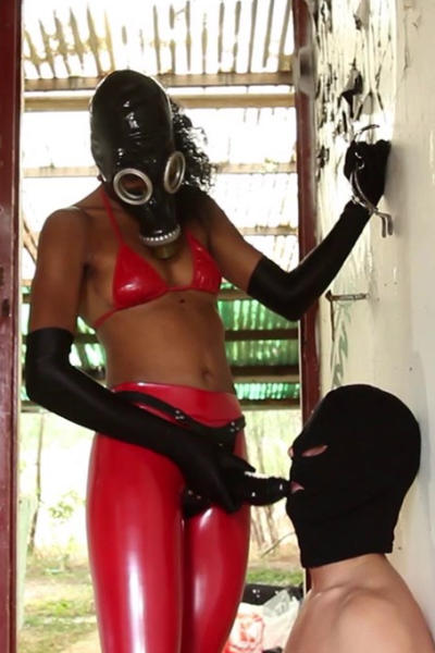 Latex Lady TINA and obediant slaveboy