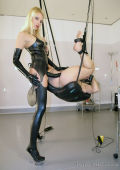 Latex Domina with big plastic dick