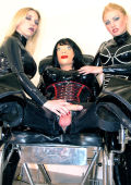Male dolled up latex slave and two latex bitches