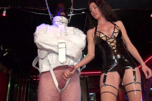Milking a slave in a straightjacket