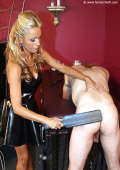 Blonde Domme in latex dress spanks pale sub
